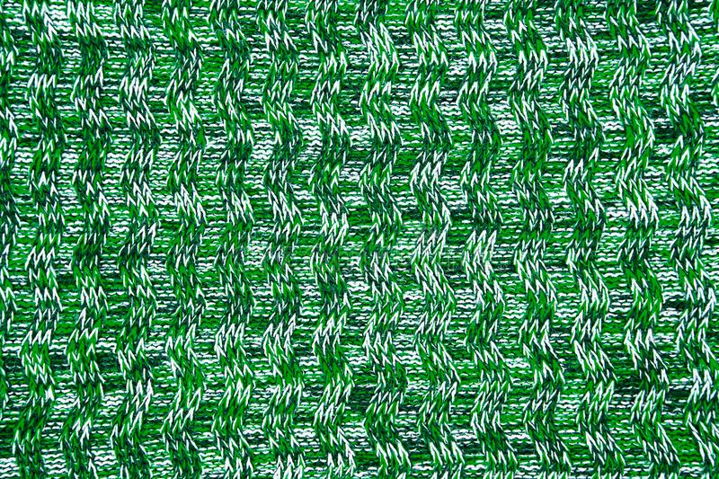 Wool scarf or sweater texture close up. green Knitted jersey background with a relief pattern. royalty free stock photo