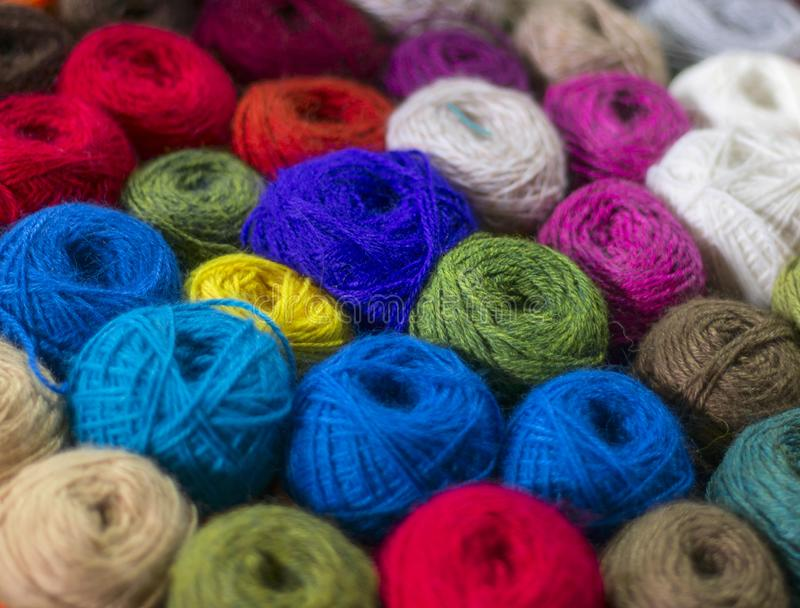 Wool yarn ball. Colorful threads for needlework. Colorful fabric texture background. Image stock images