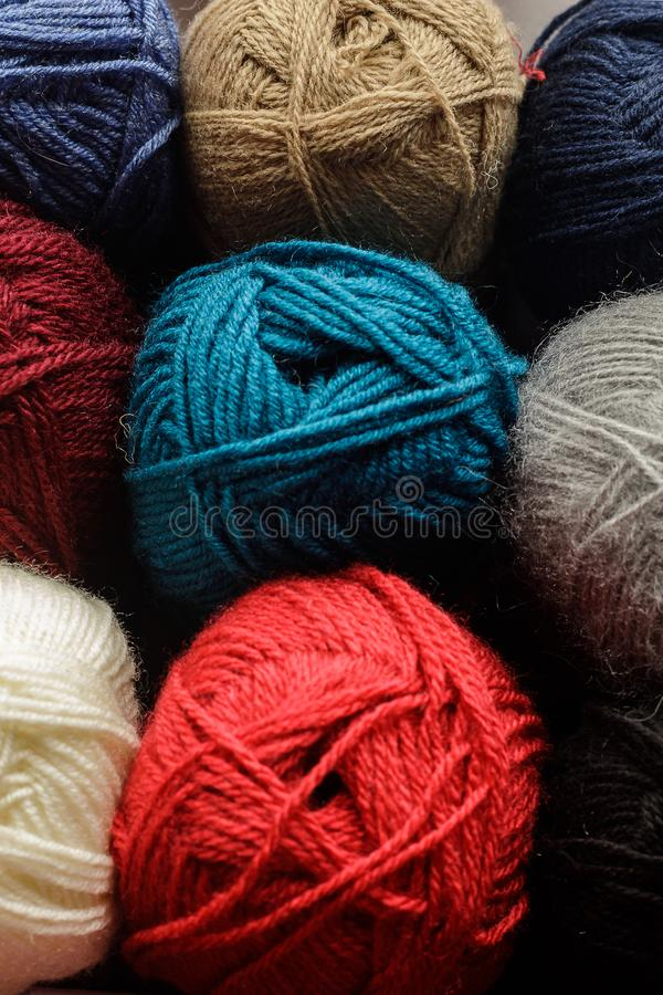 Wool yarn for knitting. A bunch of colorful skeins of wool yarn close-up stock photography