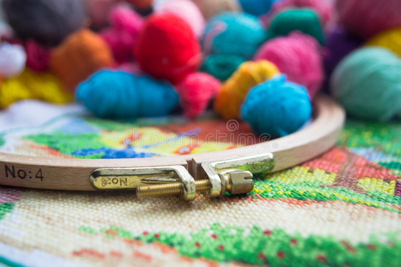 Woolen balls of yarn, tambour and embroidery. royalty free stock image