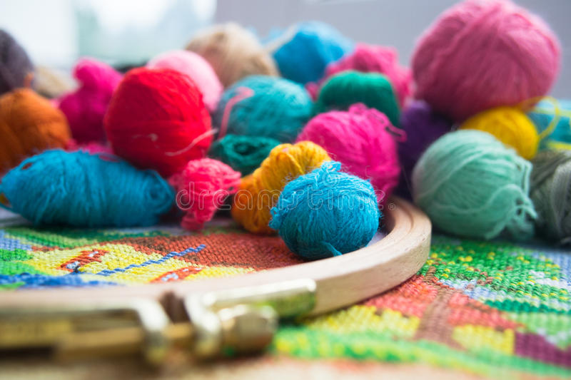 Woolen balls of yarn, tambour and embroidery. royalty free stock photos
