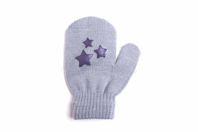 Woolen Handschuh des Babys lokalisiert auf weißem Hintergrund lizenzfreie stockfotografie