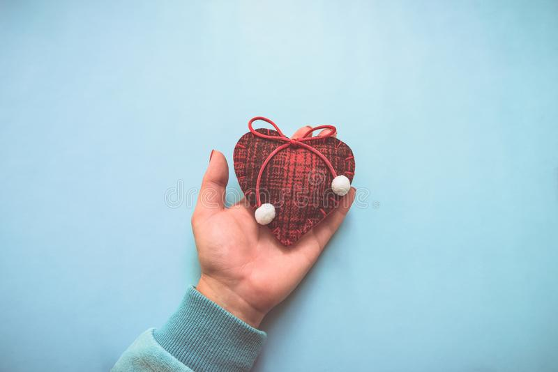 Woolen heart in his hand. Valentine Concept, instagram effect. Woolen heart in his hand. Valentine Concept, instagram effect stock photo