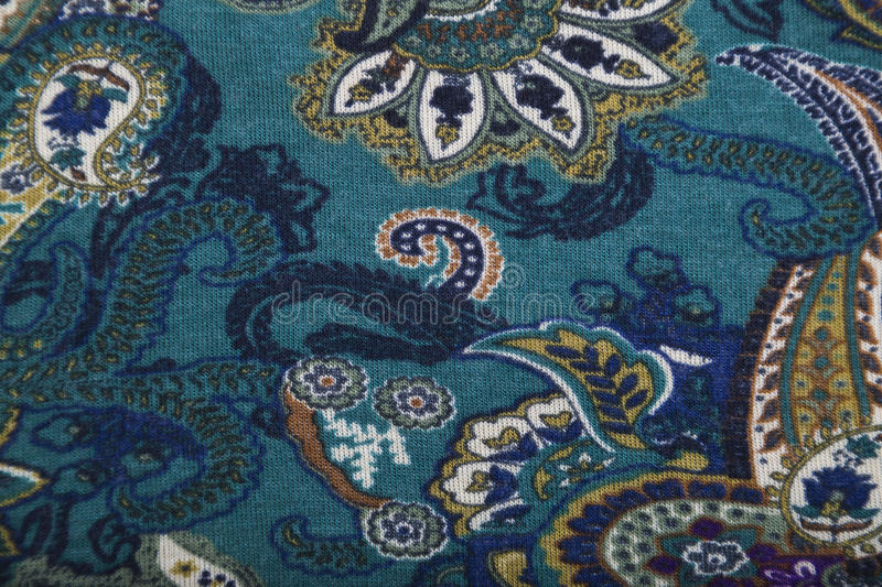 Woolen knitwear fabric with multicolored floral paisley pattern. Woolen knitwear fabric with multicolored bright floral paisley pattern in green, yellow and blue stock images