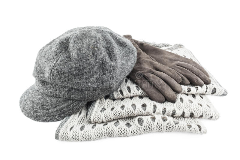 Woolen scarf, cap and gloves isolated on white background. Gray female accessory royalty free stock photography