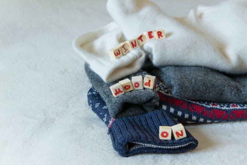 Woolen Strickjacken mit 'Winterstimmung AUF 'Text stockfoto
