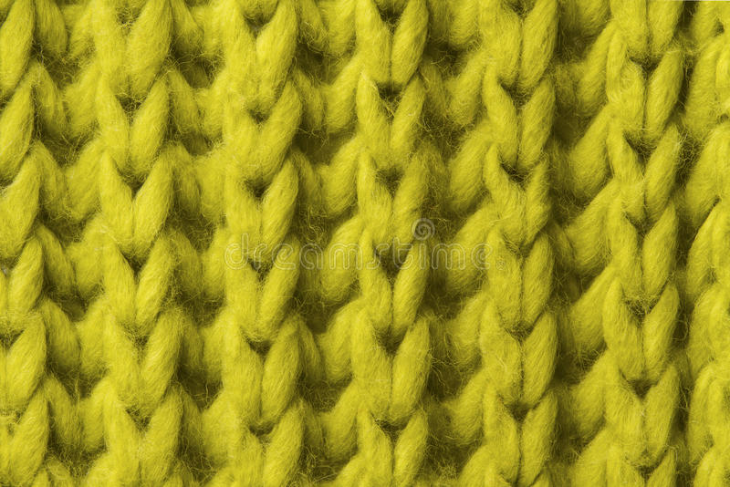 Woolen texture background, knitted wool fabric, green hairy fluffy textile. Woolen texture background close up, knitted wool fabric, green hairy fluffy textile royalty free stock photo