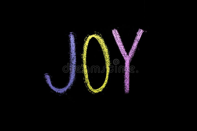 "Word ""joie ""drawned sur le tableau photo stock"