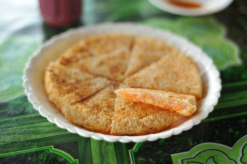 "Tumpik. The word ""tumpik"" generally means ""pancake"". It is a Melanau dish made from sago flour called 'lemantak' and dried royalty free stock photo"