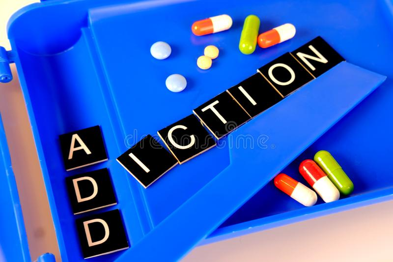 Word addiction on a pharmaceutical tablet counter royalty free stock photos