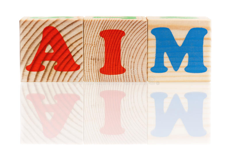 Word aim. Composed from wood cubes isolated on white background royalty free stock image