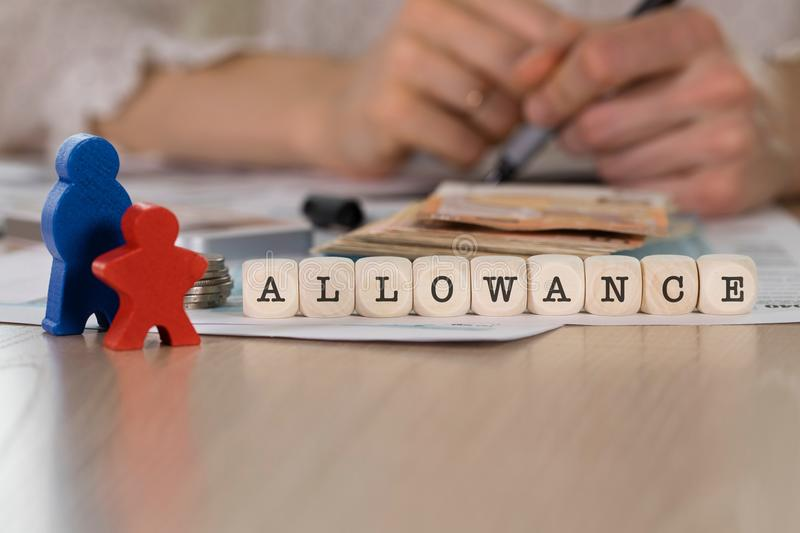 Word ALLOWANCE composed of wooden letters. Closeup royalty free stock images