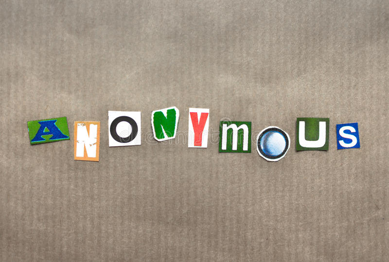 The word anonymous. Written with paper letters royalty free stock photo