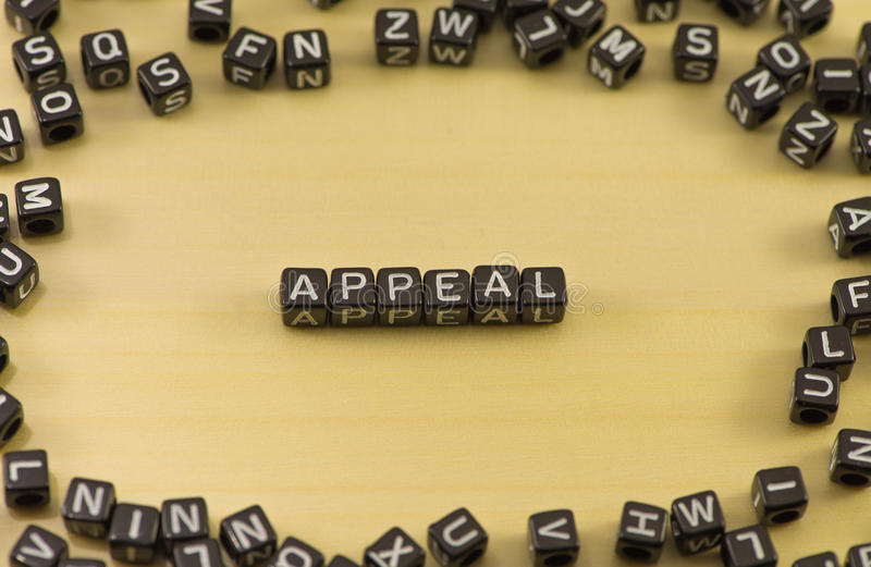 The word appeal. On wood background stock photo