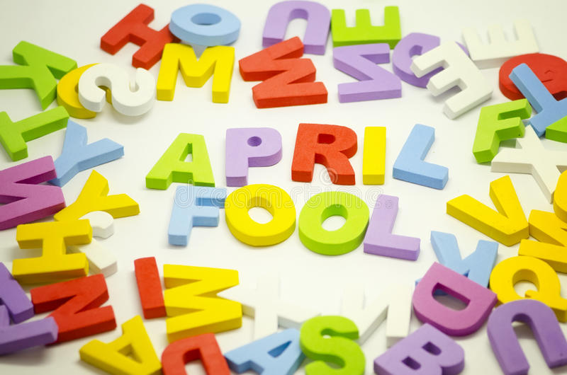 Word april fool using alphabet block on white background royalty free stock images