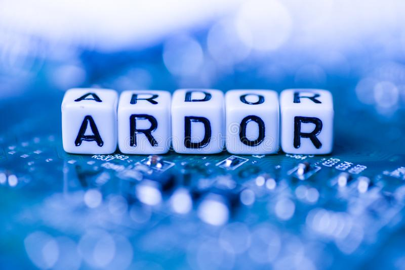 Word ARDOR formed by alphabet blocks on mother cryptocurrency. Closeup stock photos