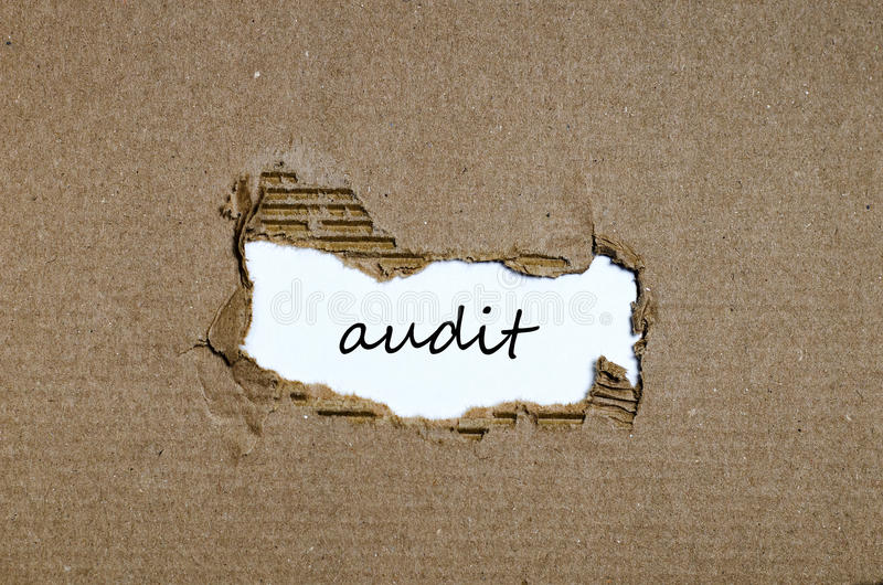 The word audit appearing behind torn paper. The word audit behind torn paper stock photography