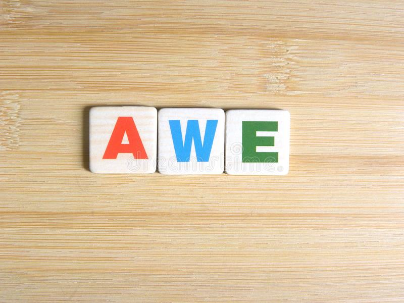 Word Awe on wood background.  stock illustration