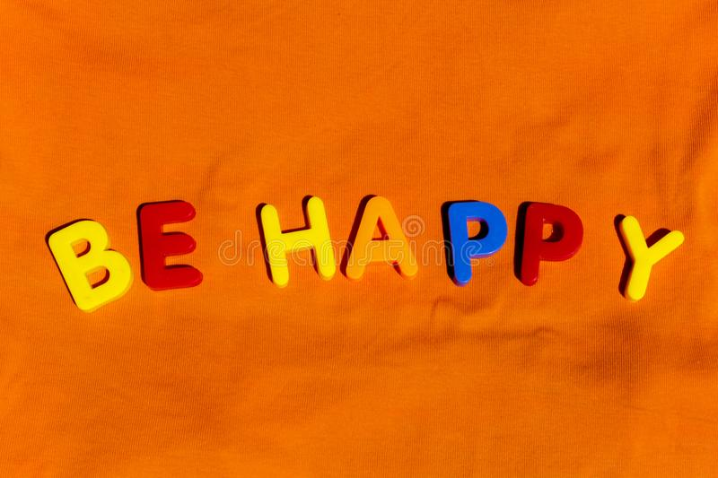 The word Be happy composed from colorful children toy letters royalty free stock photos