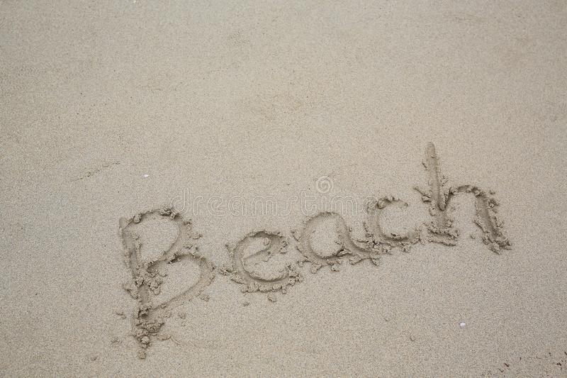 The word `Beach` in the sand of a beach.  royalty free stock photography