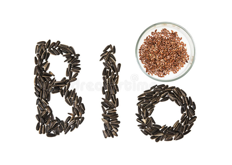 Word Bio made of sunflower seeds and linseeds on the white background royalty free stock photos