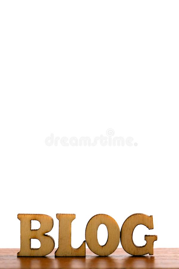 The word BLOG are made of wooden letters on a white background. Copy space on top for an inscription or logo. Isolate. stock photos