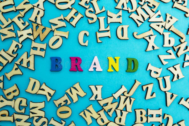 The word `brand` is lined with multicolored letters on a blue background.  royalty free stock image