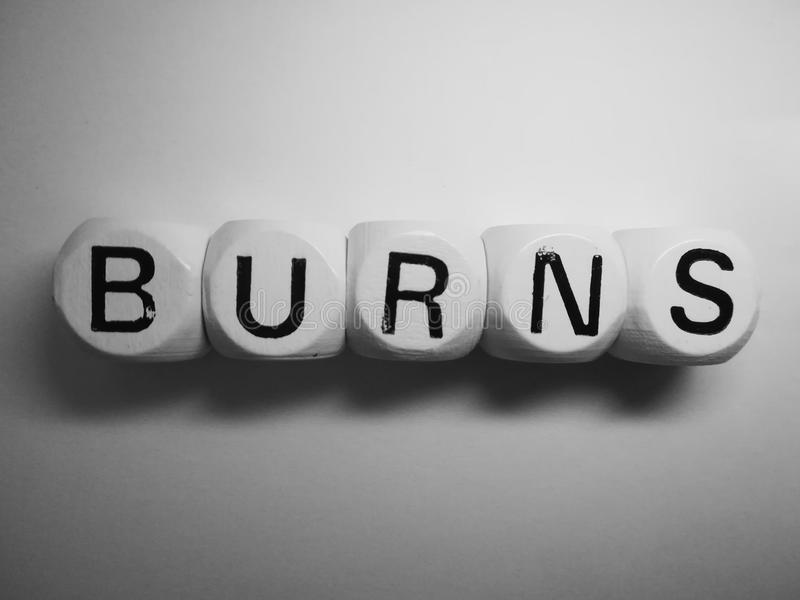 Word burns spelled on dice royalty free stock images
