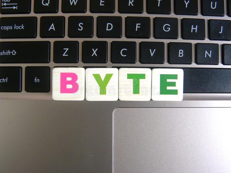Word Byte on keyboard background.  stock photos