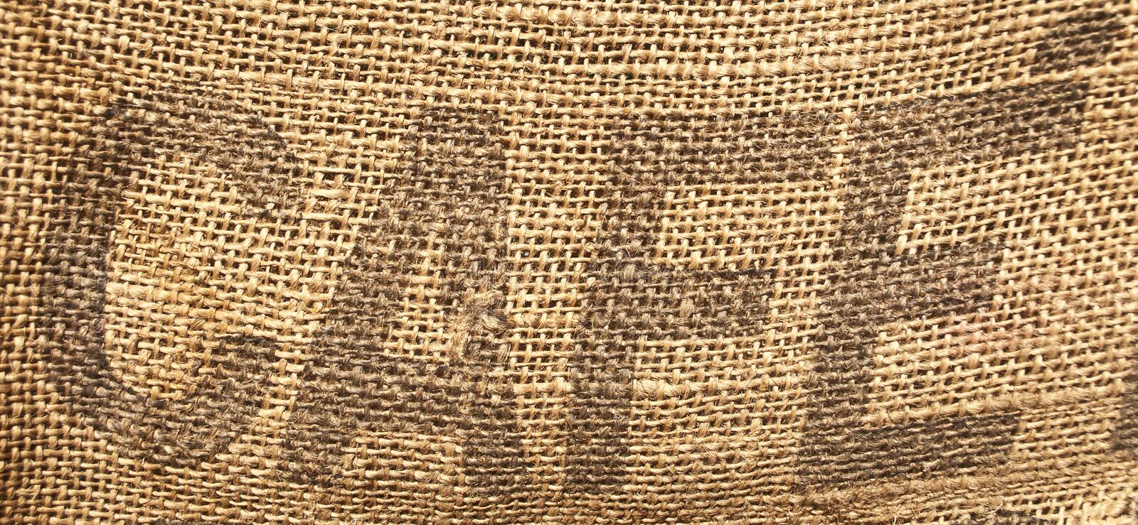 Word \'Cafe\' or \'Coffee\' written on old sack royalty free stock photography