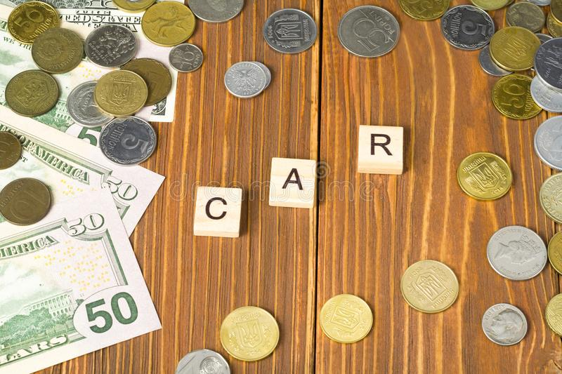 Word CAR On Wooden Cube With Money Frame At Wood Background. Finance ...
