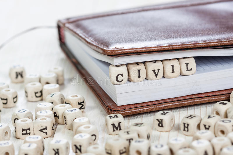 Word CIVIL on old wooden table. stock photography