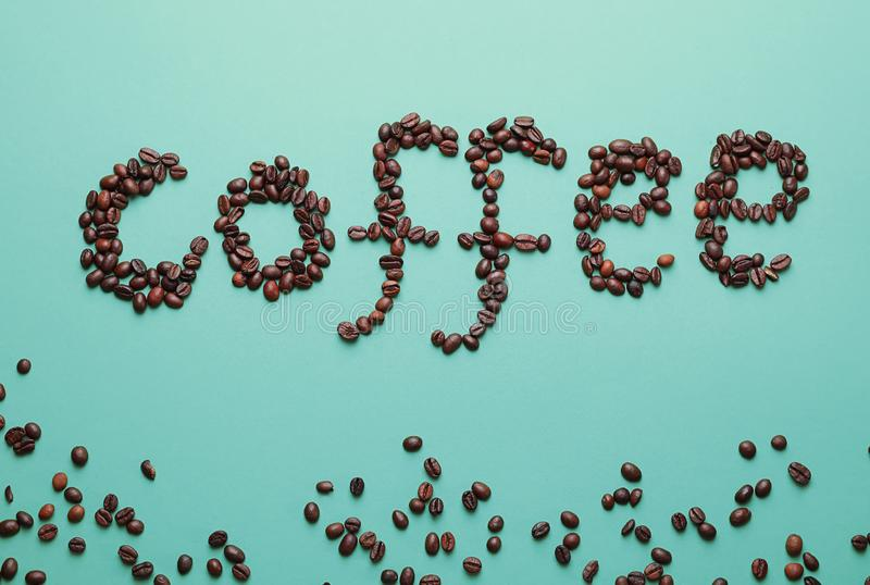 Word coffee made of beans on color background royalty free stock photo