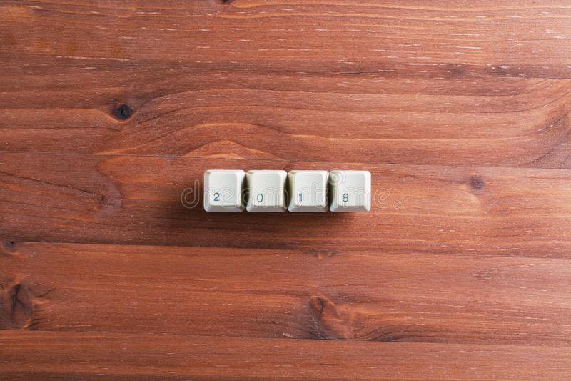2018 word on computer keyboard keys on wooden background. New Ye stock images