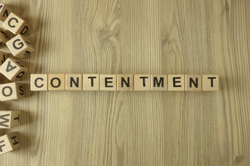 Word contentment from wooden blocks stock images
