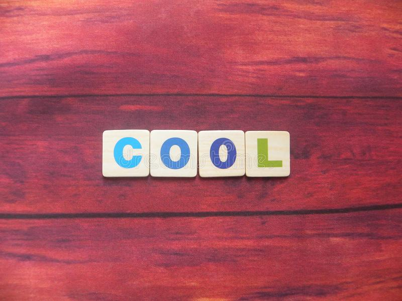 Word Cool on wood. Background royalty free stock photos