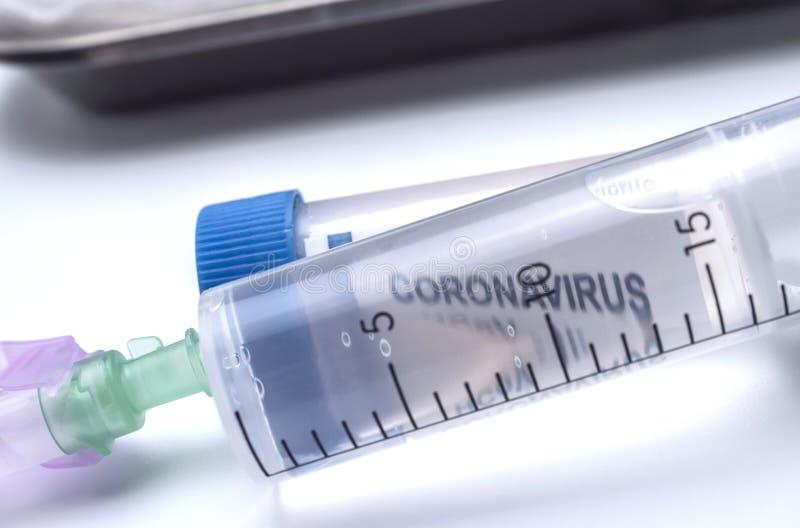 Word coronavirus through a syringe. Conceptual image royalty free stock photos
