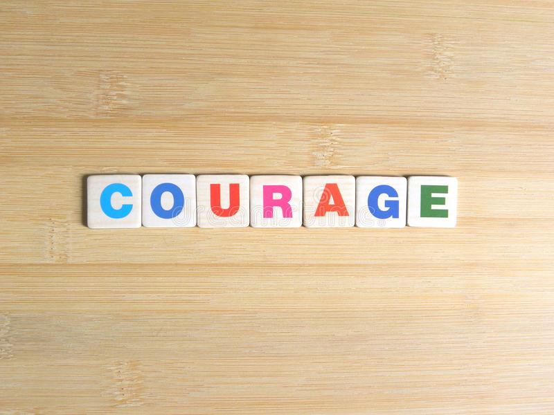 Word Courage on wood background.  vector illustration