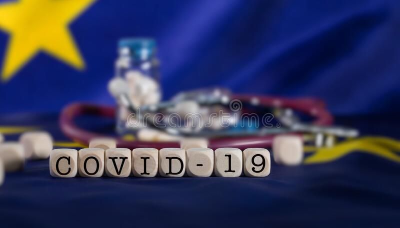 Word  COVID-19  composed of wooden letter stock photos