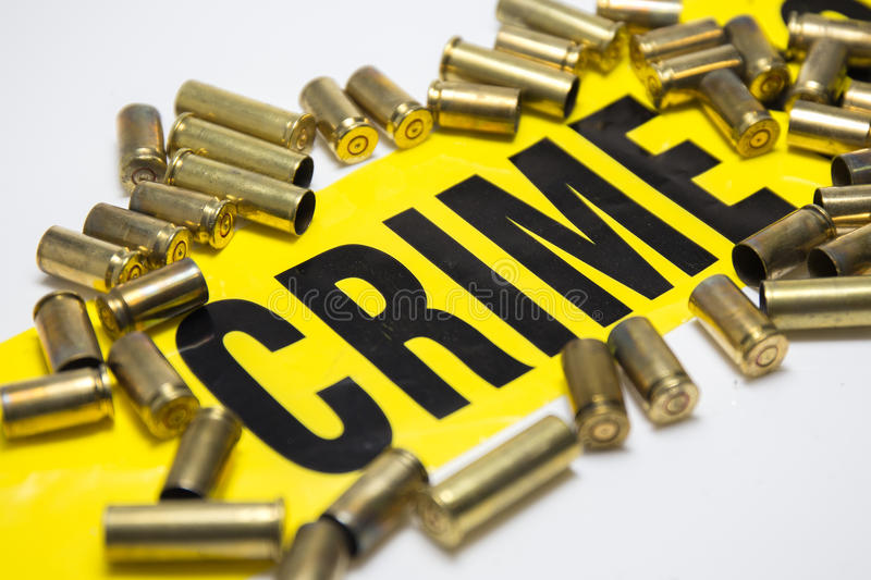 Word crime with brass bullet case concept on white background stock image