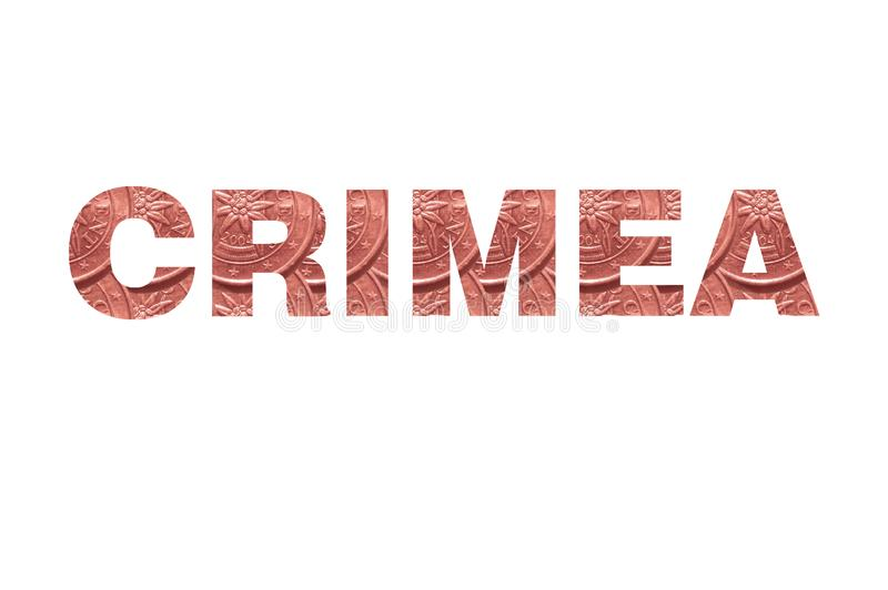 The word `Crimea` on a white background, inside the letters of a coin 2 euro cent. royalty free stock photos