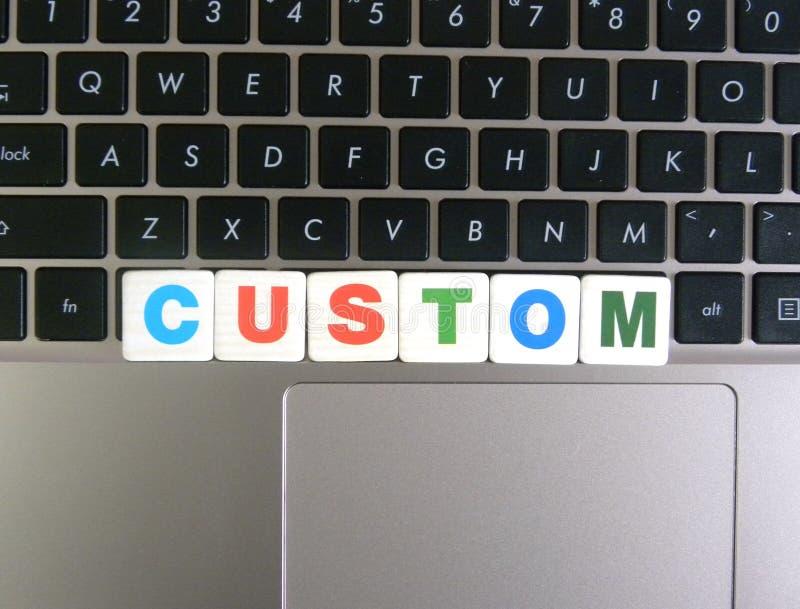 Word Custom on keyboard background stock images