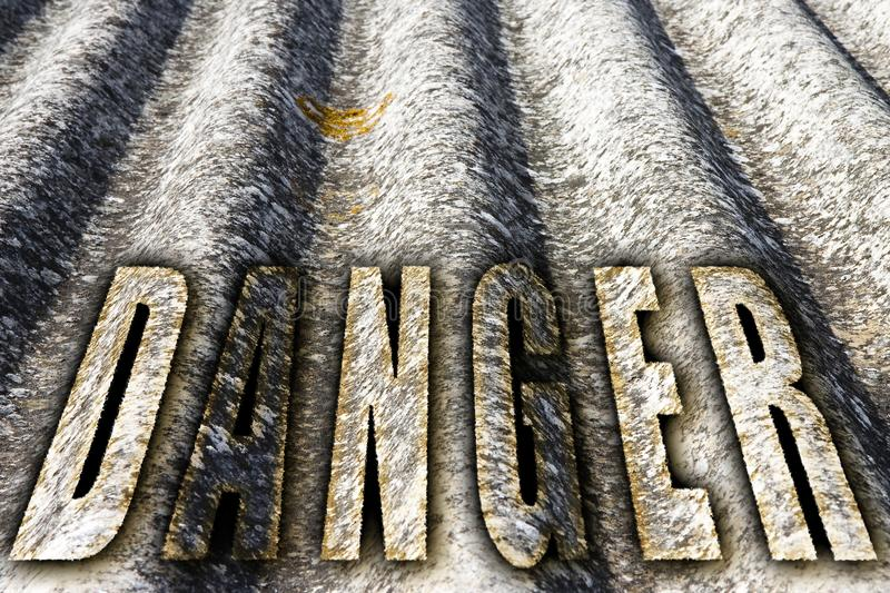 The word `danger` written with letters having asbestos graphics background royalty free stock photography