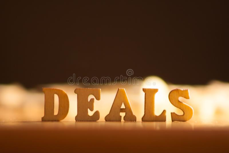 Word deals. The word deals written with wooden letters background royalty free stock photo