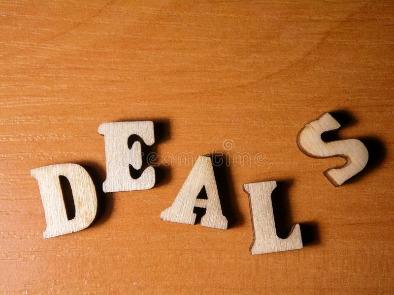 Word deals. The word deals written with wooden letters background stock images