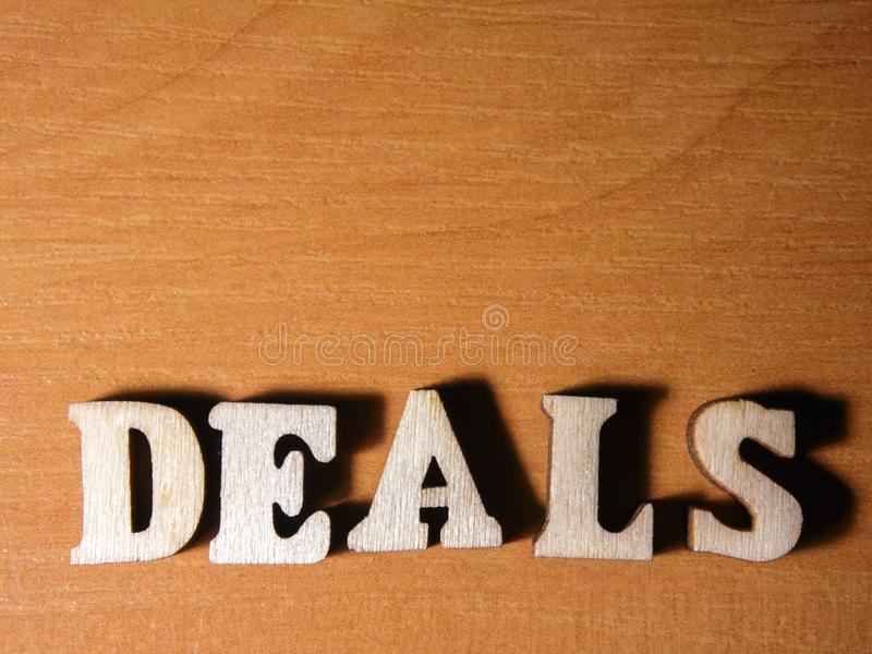 The word deals. Written with wooden letters background stock image