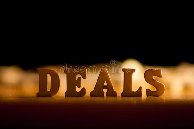 Word deals. The word deals written with wooden letters background stock photo