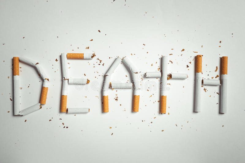 Word DEATH, made of cigarettes. Studio shot royalty free illustration