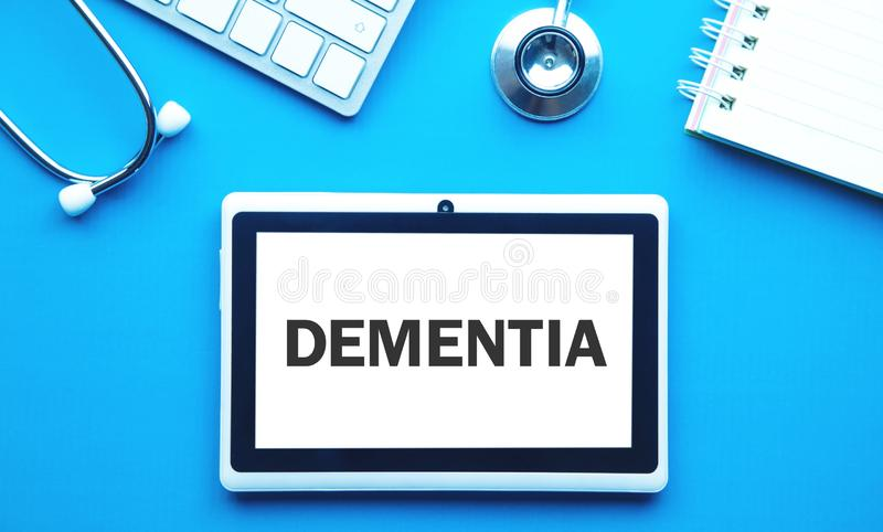 Word Dementia on tablet screen. Medical concept royalty free stock photography