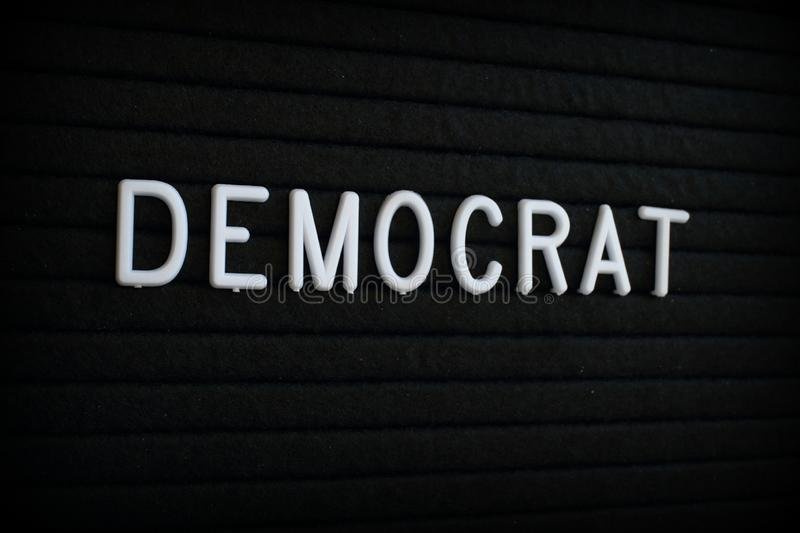 The Word Democrat on a Letter Board. The word Democrat in white plastic letters on a black letter board stock photo